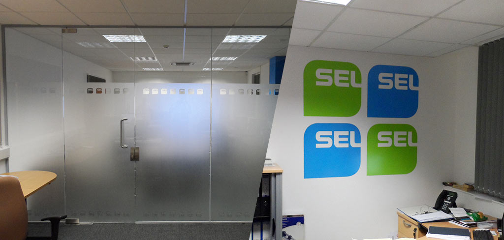 Frosted logos applied to an internal glass wall and other internal wall graphics