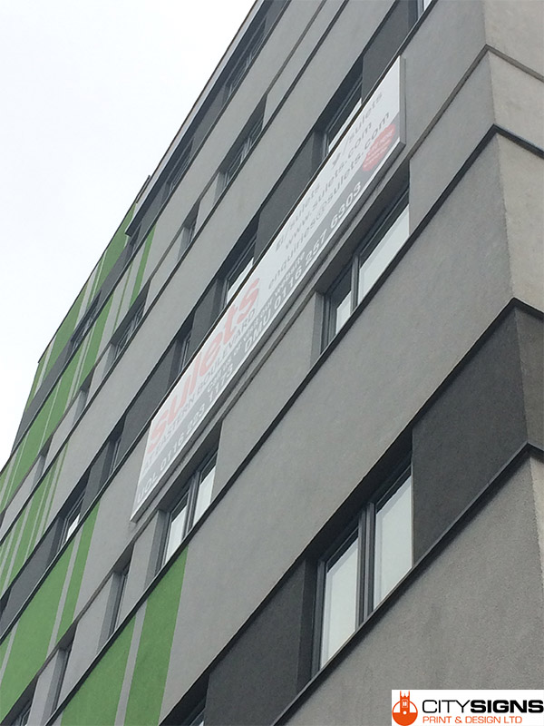 external-pvc-banners-fitted-on-building